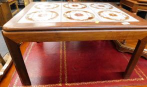 A vintage G-plan tile topped coffee table, with oblong top on chamfered legs, labelled, 41cm high,