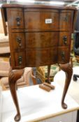 A 20thC walnut drop leaf side table, with shaped drawers each with tier drop handles on cabriole