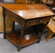 An oak Ercol style side table, of shaped form with frieze drawer on turned legs joined by an under