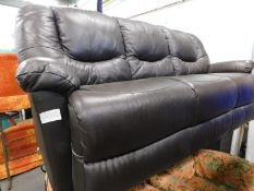 A brown leather three seater sofa. The upholstery in this lot does not comply with the 1988 (