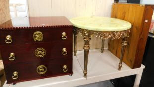 An onyx finish occasional table, with circular top on elaborate turned reeded legs, 53cm high,