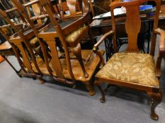 A set of six (4+2) Queen Anne design dining chairs, each with drop in seats in floral material on