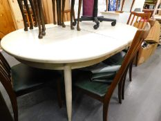 A vintage 1960s G Plan D end extending dining table, on turned legs later painted cream, 68cm