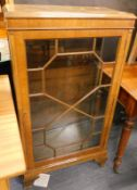 A mahogany display cabinet, with astragal glazed door, on shaped feet, with a moulded fix top, 110cm