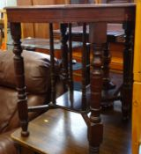 An Edwardian mahogany two tier occasional table on turned legs.