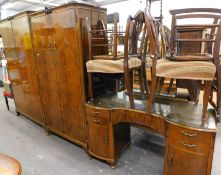 A mid-20thC walnut finish bedroom suite, comprising lady and gentleman wardrobes, mirror back kidney
