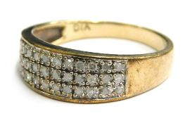 A 9ct gold diamond set dress ring, with three rows of tiny diamonds, approximately 0.25ct overall, r