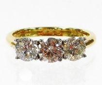 An 18ct gold diamond three stone ring, with three round brilliant cut diamonds, approx 5.2mm x 5.2mm