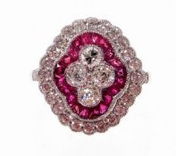 A Victorian style ruby and diamond cluster ring, with four central round brilliant cut diamonds, wit