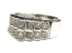 A 9ct white gold diamond set dress ring, with four tiered design, each tier set with two diamonds, t