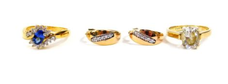 A Tru diamonds dress ring, set in yellow metal, with sapphire and white stones, in a crossover desig