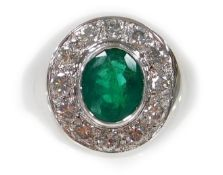 An 18ct white gold oval emerald and diamond cluster ring, set with oval cut emerald 1.70cts, surroun