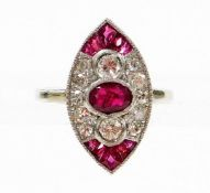 A ruby and diamond marquise shaped panel ring, oval cut ruby in rub over setting, with two round bri