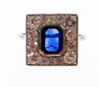 An Art Deco style sapphire and diamond ring, with central octagon cut sapphire, 7.2mm x 5.4mm x 2.4m