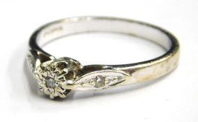 A 9ct white gold diamond set dress ring, with tiny illusion set diamond to centre and a tiny diamond