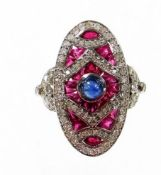 An Art Deco style ruby, diamond and sapphire cocktail ring, with arrangement of baguette cut rubies
