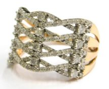 A 9ct gold dress ring, of four row cross weave design, in two sections, with a four row split should