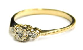 A 9ct gold dress ring, with small tiny diamond set claw design, each stone illusion set on a raised