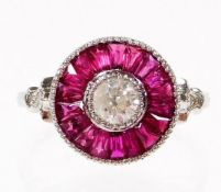 A ruby and diamond target ring, set with central old cut diamond 4.2mm x 4.2mm x 3mm, approx 0.50cts