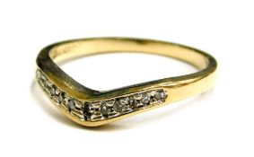 A 9ct gold dress ring, of wishbone design, set with tiny diamonds in platinum setting, ring size K,