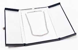 A platinum double row diamond necklace, with graduated centre design of round brilliant cut diamonds