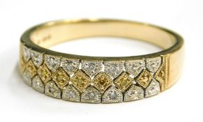 A 9ct gold half hoop eternity ring, set with an arrangement of white and yellow metal, gradually set