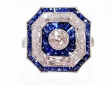 A sapphire and diamond dress ring, with chamfered edges, set with a central diamond, 4.6mm x 4.6mm x