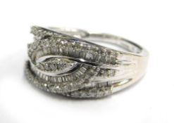 A 9ct white gold dress ring, set with arrangement of round brilliant and baguette cut diamonds, on t