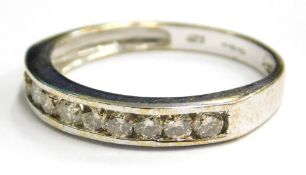 A 9ct white gold half hoop eternity ring, set with various white stones, in channel setting, ring si