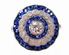 A sapphire and diamond dress ring, with central diamond 4.4mm x 4.4mm x 2.2mm, by calibre cut sapphi