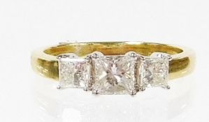 An 18ct gold diamond trilogy ring, with three princess cut diamonds, the centre stone 4.2mm x 4mm x