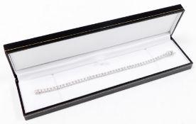 An 18ct white gold diamond set tennis bracelet, with fourty eight round brilliant cut diamonds, each