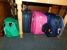 Three suitcases, together with a Carlton overnight bag. (4)