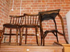 A pair of IBEX style penny seat kitchen chairs, together with a mahogany occasional table. (3)