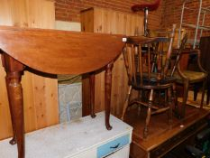 An Edwardian mahogany drop leaf table, 72cm high, 74cm wide, 91cm deep., together with an