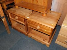 A pair of waxed pine bedside cabinets, 53cm high, 51cm wide, 48cm deep.