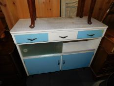 A 1960's Formica top kitchen cabinet, of three drawers, glass sliding doors and two cupboards,