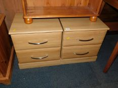 A pair of oak effect two drawer bedside chests, each 49cm high, 45cm wide, 41cm deep.