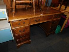 A reproduction mahogany twin pedestal desk, with brown tooled leather top, 77cm high, 123cm wide,