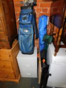 A steel filing cabinet, golf clubs, three camping seats and a workmate. (6)