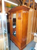 A late Victorain walnut wardrobe, with single mirror door and lower drawer, 202cm high, 129cm