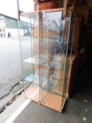 A pair of glass display cabinets enclosing three shelves, 164cm high, 43cm wide, 37cm deep.