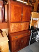 A reproduction mahogany cocktail cabinet, with upper and lower cupboards, 176cm high, 88cm wide,