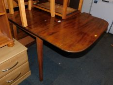 A mid 20thC drop leaf kitchen table, with mahogany top, 77cm high, 144cm wide, 84cm deep.