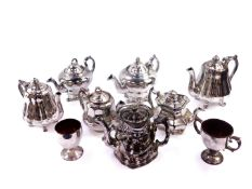 Seven Victorian silver lustre terracotta teapots, one formed as a double sided Toby, together with a