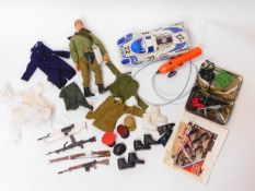 An Action Man figure, clothing and accessories, together with a Tayo remote control Martini Racing