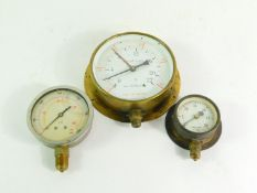 A Tomey brass cased circular altitude gauge, 18cm diameter., a Bar and PSI gauge, and a vacuum in.