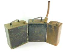 An Esso oil can., Pratt oil can with nozzle., and a Shell Mex oil can. (3)