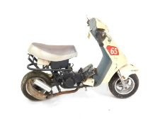 A child's Monkey bicycle, with Fun Scooter 65 Moto Sports decals.