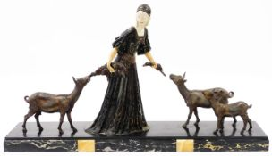 A Continental Art Deco bronzed and marble figure group, formed as a lady in flowing robes feeding